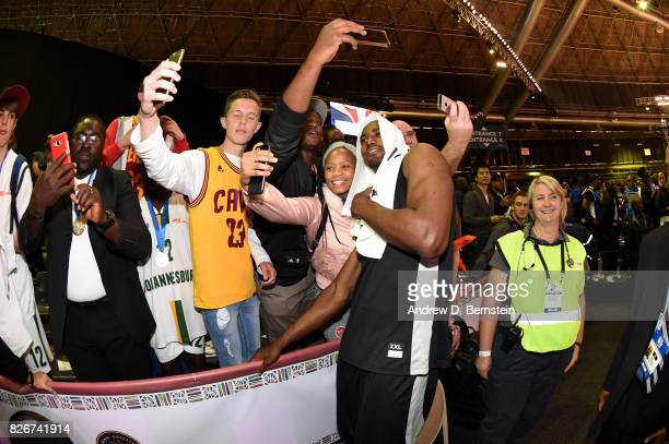 Serge Ibaka of Team Africa takes pictures with fans after the game against Team World in the 2017 Africa Game as part of the Basketball Without...
