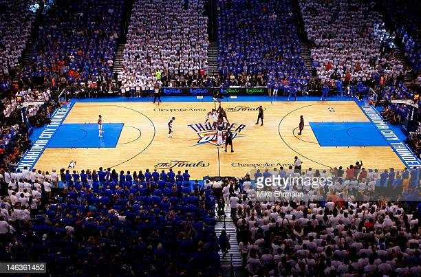 Serge Ibaka of the Oklahoma City Thunder and Chris Bosh of the Miami Heat go after the opening tip to start Game Two of the 2012 NBA Finals at...