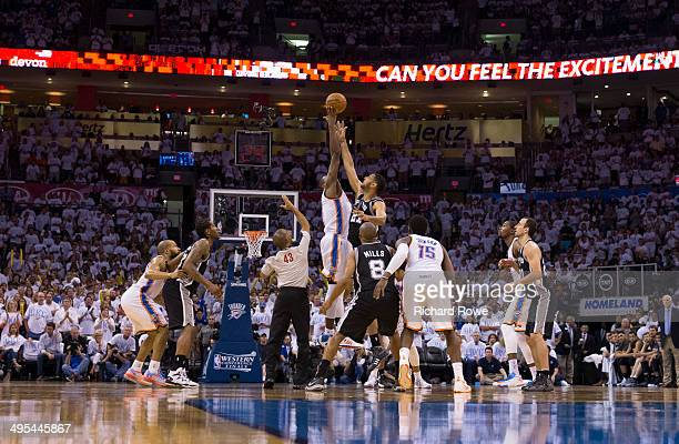 Serge Ibaka of the Oklahoma City Thunder and Tim Duncan of the San Antonio Spurs go up for a tip off in Game 6 of the Western Conference Finals...