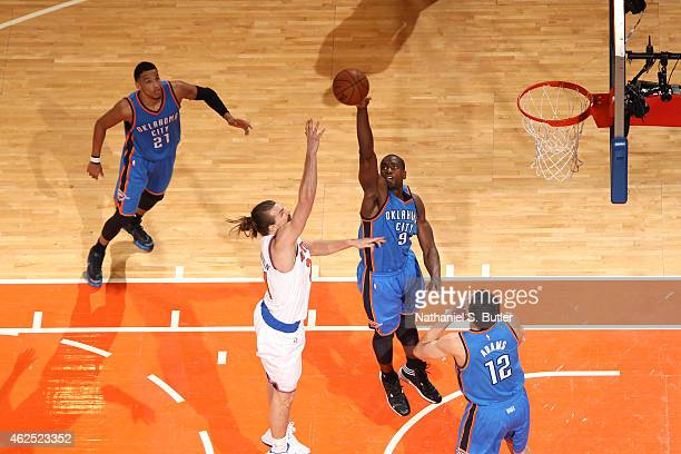 Serge Ibaka of the Oklahoma City Thunder blocks a shot against Lou Amundson of the New York Knicks on January 28 2015 at Madison Square Garden in New...