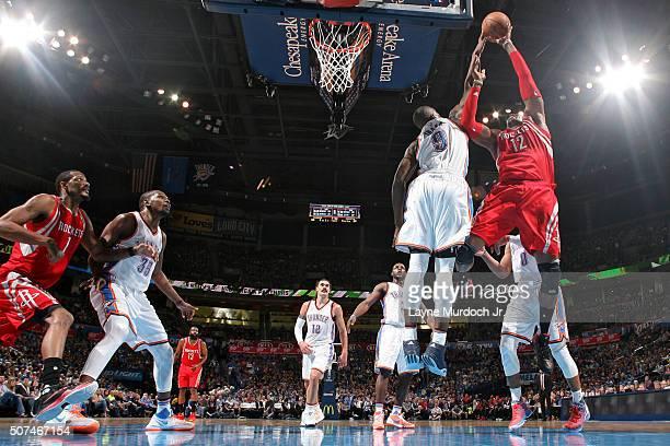 Serge Ibaka of the Oklahoma City Thunder blocks the shot of Dwight Howard of the Houston Rockets on January 29 2016 at Chesapeake Energy Arena in...
