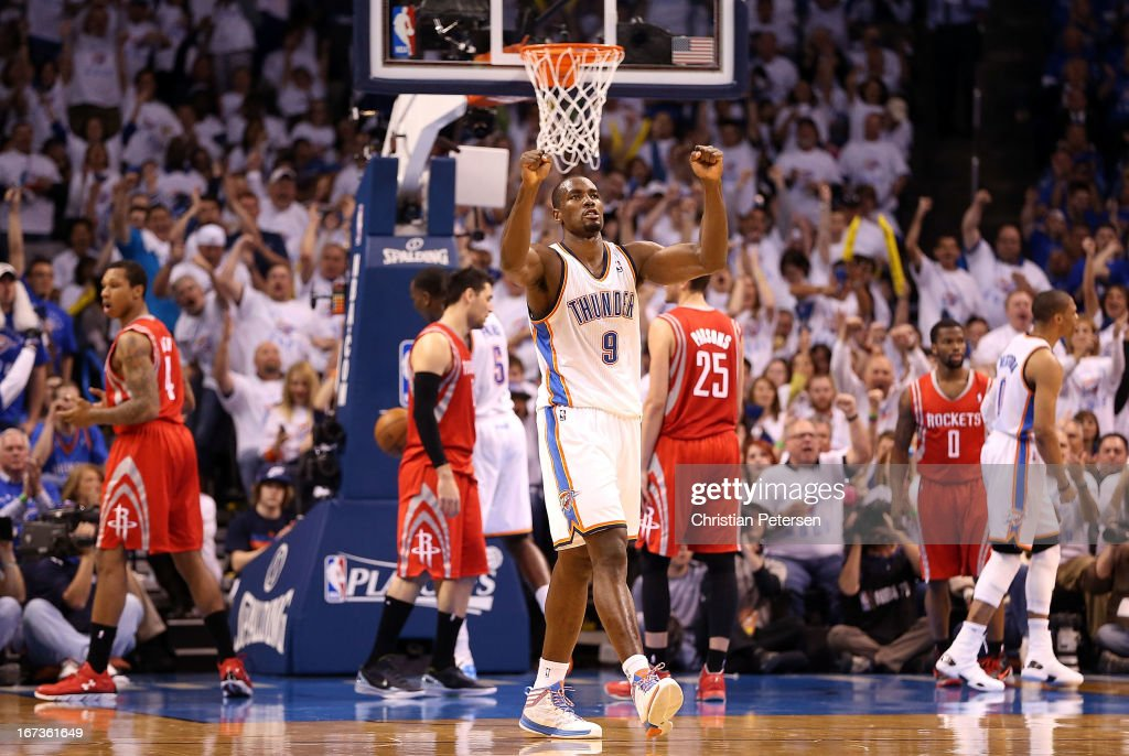 Serge Ibaka #9 of the Oklahoma City Thunder celebrates after Russell Westbrook (R) scored against the Houston Rockets during the third quarter of Game Two of the Western Conference Quarterfinals of the 2013 NBA Playoffs at Chesapeake Energy Arena on April 24, 2013 in Oklahoma City, Oklahoma.