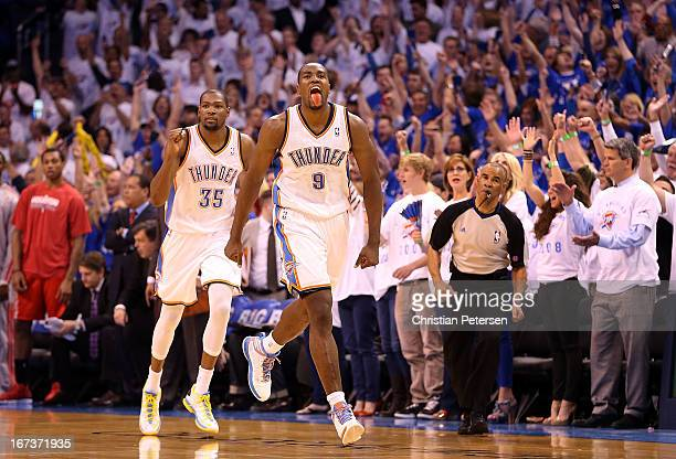 Serge Ibaka of the Oklahoma City Thunder celebrates ahead of Kevin Durant after Ibaka scored against the Houston Rockets during fourth quarter of...