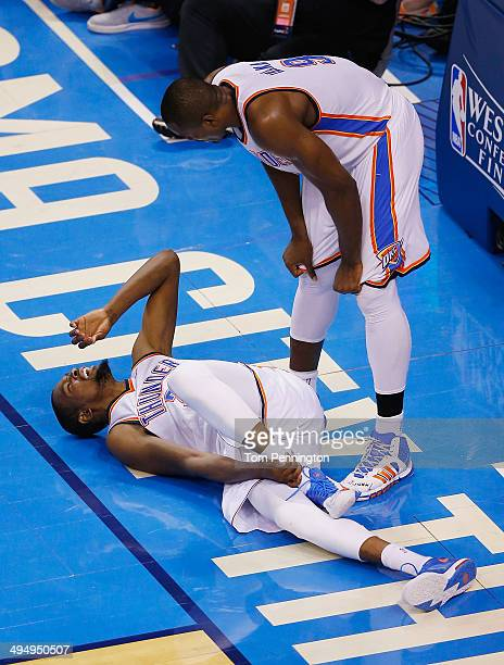 Serge Ibaka of the Oklahoma City Thunder checks on Kevin Durant after he was knocked to the court against the San Antonio Spurs in the second half...