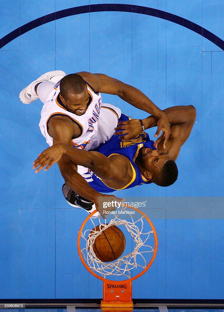 Serge Ibaka #9 of the Oklahoma City Thunder dunks against Festus Ezeli #31 of the Golden State Warriors in the first half in game three of the Western Conference Finals during the 2016 NBA Playoffs at Chesapeake Energy Arena on May 22, 2016 in Oklahoma City, Oklahoma.