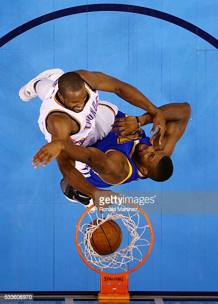 Serge Ibaka of the Oklahoma City Thunder dunks against Festus Ezeli of the Golden State Warriors in the first half in game three of the Western...