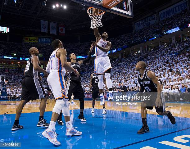 Serge Ibaka of the Oklahoma City Thunder dunks the ball against the San Antonio Spurs in Game 6 of the Western Conference Finals during the 2014 NBA...