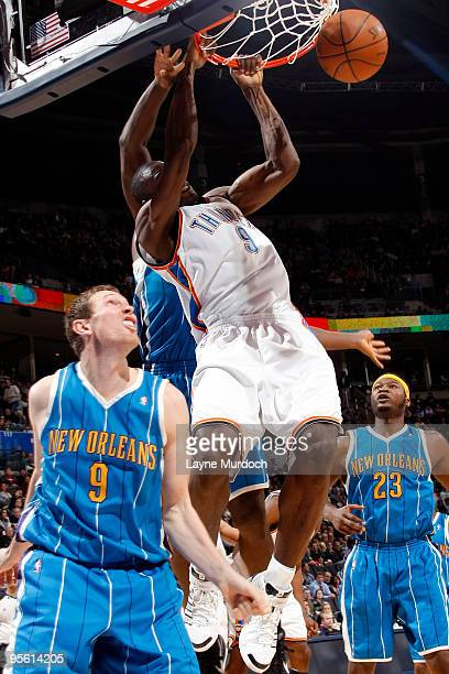 Serge Ibaka of the Oklahoma City Thunder dunks the ball on Darius Songaila of the New Orleans Hornets on January 6 2010 at the Ford Center in...