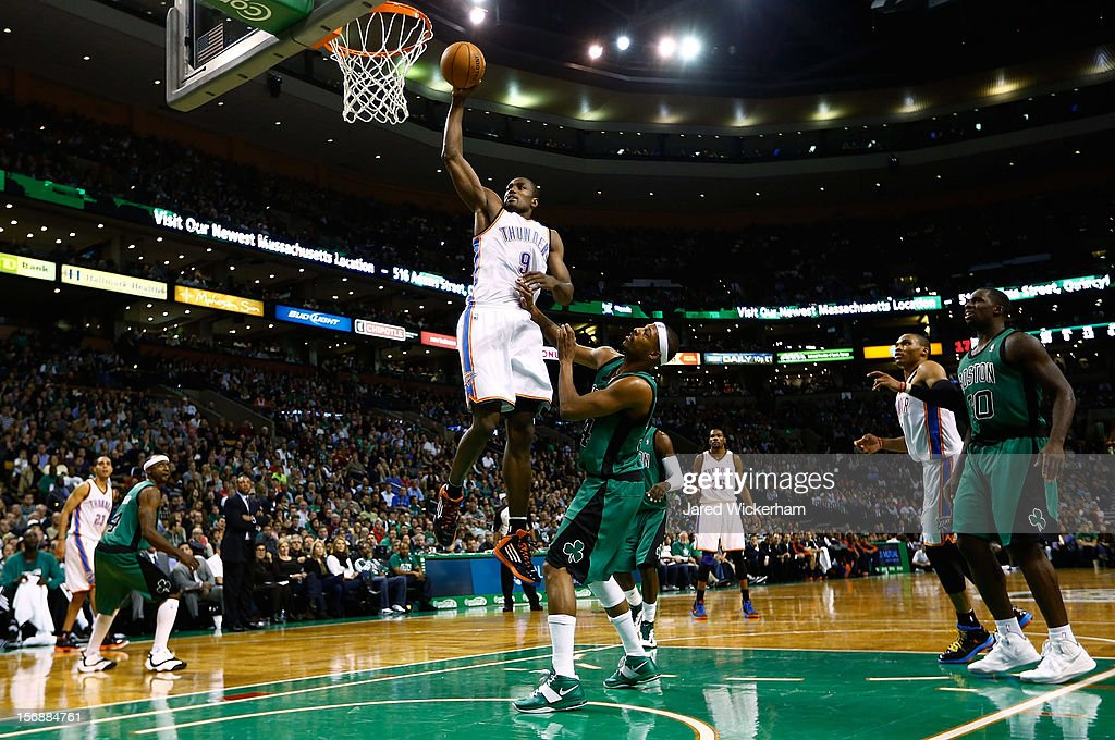 Serge Ibaka #9 of the Oklahoma City Thunder dunks the ball over Paul Pierce #34 of the Boston Celtics during the game on November 23, 2012 at TD Garden in Boston, Massachusetts.