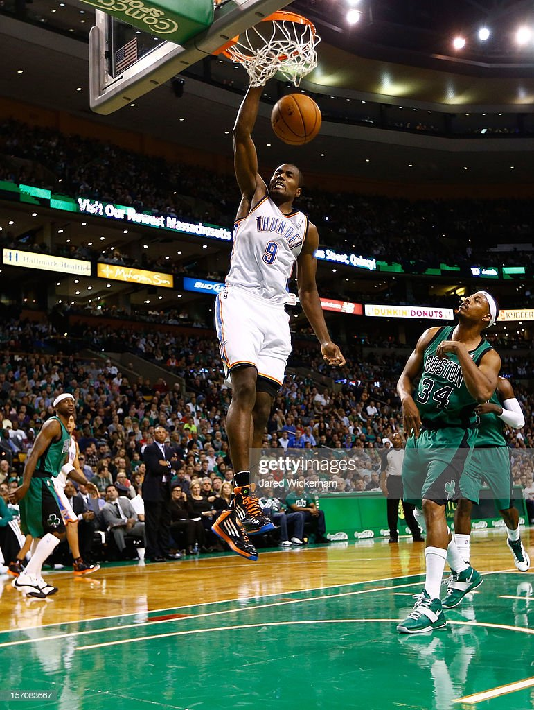 Serge Ibaka #9 of the Oklahoma City Thunder dunks the ball over Paul Pierce #34 of the Boston Celtics during the game on November 23, 2012 at TD Garden in Boston, Massachusetts.