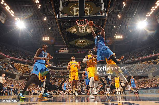 Serge Ibaka of the Oklahoma City Thunder goes up for a shot against the Indiana Pacers at Bankers Life Fieldhouse on April 13 2014 in Indianapolis...