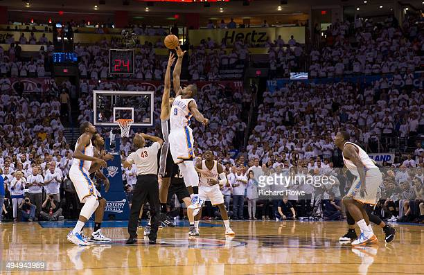 Serge Ibaka of the Oklahoma City Thunder goes up for the opening tip against the San Antonio Spurs in Game 6 of the Western Conference Finals during...