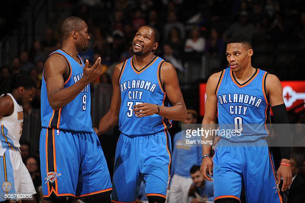 Serge Ibaka of the Oklahoma City Thunder Kevin Durant of the Oklahoma City Thunder and Russell Westbrook of the Oklahoma City Thunder talk during the...