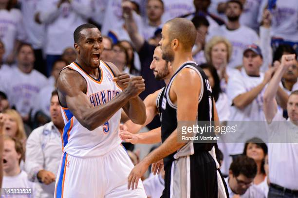 Serge Ibaka of the Oklahoma City Thunder reacts after a play as Tony Parker and Manu Ginobili of the San Antonio Spurs look on in Game Six of the...