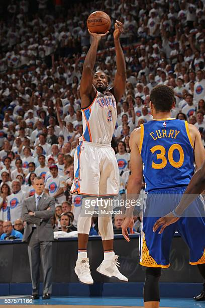 Serge Ibaka of the Oklahoma City Thunder shoots a three point basket in Game Four of the Western Conference Finals against the Golden State Warriors...