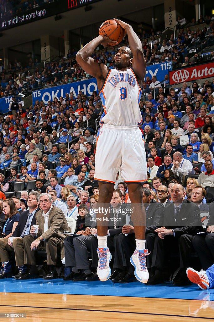 Serge Ibaka #9 of the Oklahoma City Thunder shoots a three-pointer against the Washington Wizards on March 27, 2013 at the Chesapeake Energy Arena in Oklahoma City, Oklahoma.