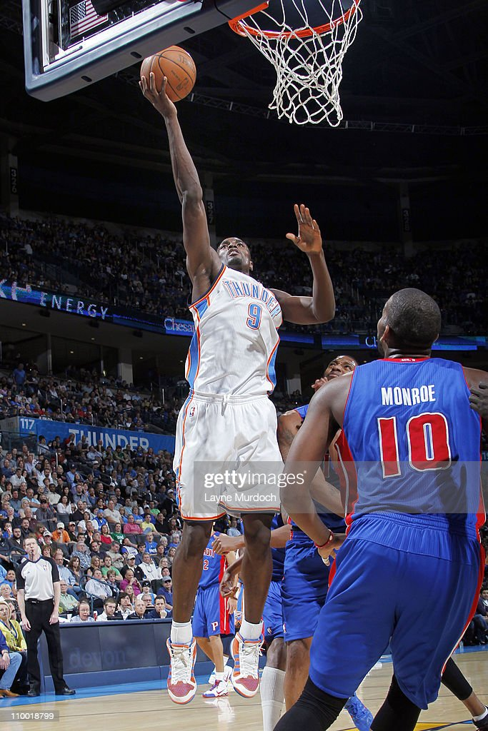 Serge Ibaka #9 of the Oklahoma City Thunder shoots against Greg Monroe #10 of the Detroit Pistons during the game on March 11, 2011 at the Oklahoma City Arena in Oklahoma City, Oklahoma.