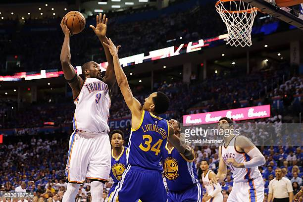Serge Ibaka of the Oklahoma City Thunder shoots against Shaun Livingston of the Golden State Warriors in the fourth quarter in game three of the...
