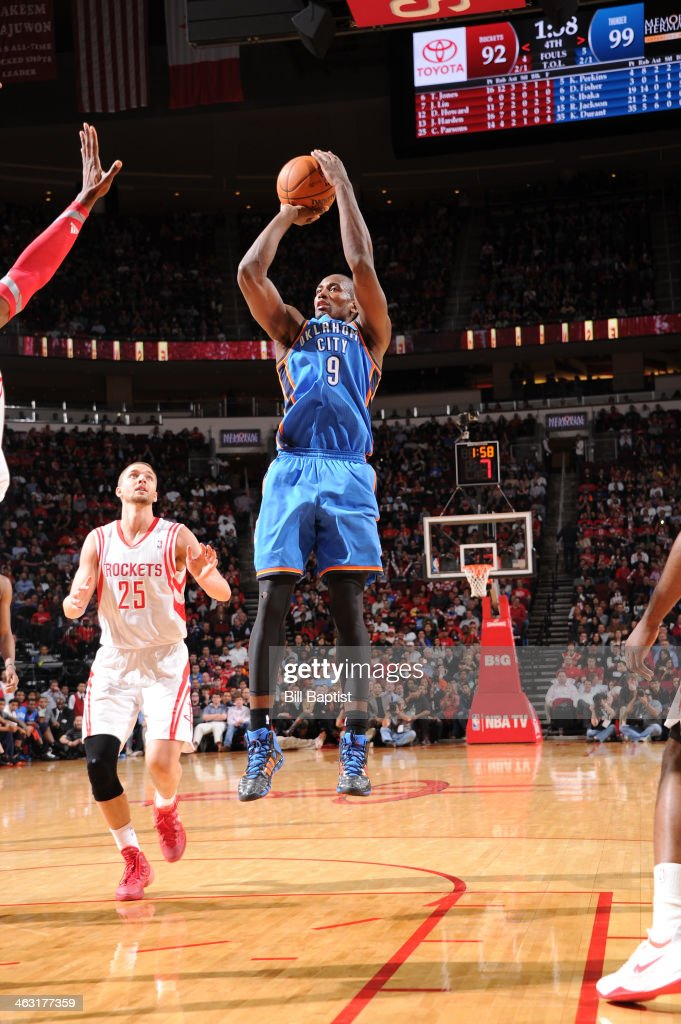 Serge Ibaka #9 of the Oklahoma City Thunder shoots against the Houston Rockets on January 16, 2014 at the Toyota Center in Houston, Texas.