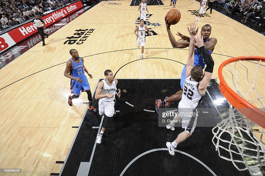 Serge Ibaka #9 of the Oklahoma City Thunder shoots against Tiago Splitter #22 of the San Antonio Spurs on March 11, 2013 at the AT&T Center in San Antonio, Texas.
