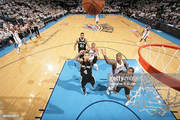 Serge Ibaka of the Oklahoma City Thunder shoots the ball against the San Antonio Spurs in Game 6 of the Western Conference Finals during the 2014 NBA...