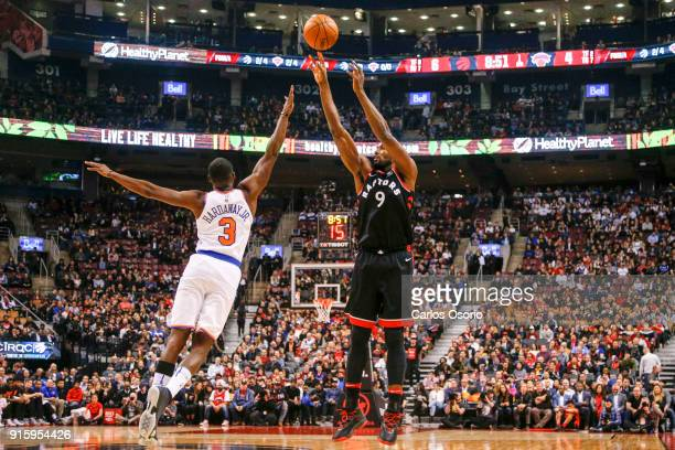 TORONTO ON FEBRUARY 8 Serge Ibaka of the Raptors makes a shot over Tim Hardaway Jr of the Knicks during the 1st half of NBA action as the Toronto...