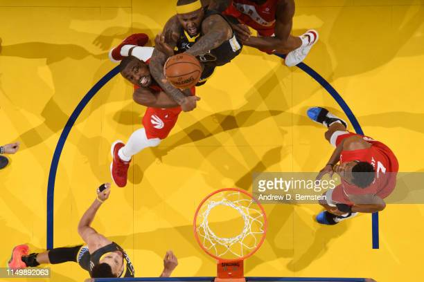 Serge Ibaka of the Toronto Raptors and DeMarcus Cousins of the Golden State Warriors go for a rebound during Game Six of the NBA Finals on June 13...