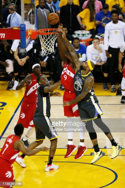 Serge Ibaka of the Toronto Raptors and DeMarcus Cousins of the Golden State Warriors battle for the ball in the first half during Game Six of the...