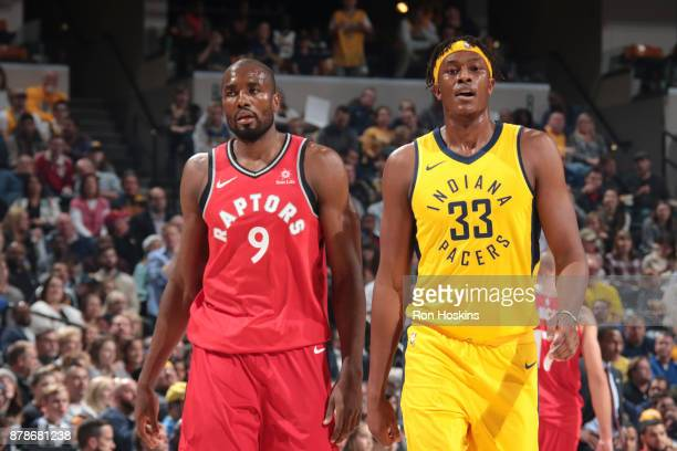 Serge Ibaka of the Toronto Raptors and Myles Turner of the Indiana Pacers looks on on November 24 2017 at Bankers Life Fieldhouse in Indianapolis...