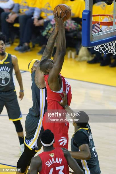 Serge Ibaka of the Toronto Raptors attempts a shot against DeMarcus Cousins of the Golden State Warriors in the first half during Game Six of the...