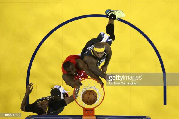 Serge Ibaka of the Toronto Raptors attempts a shot against DeMarcus Cousins of the Golden State Warriors during Game Six of the 2019 NBA Finals at...