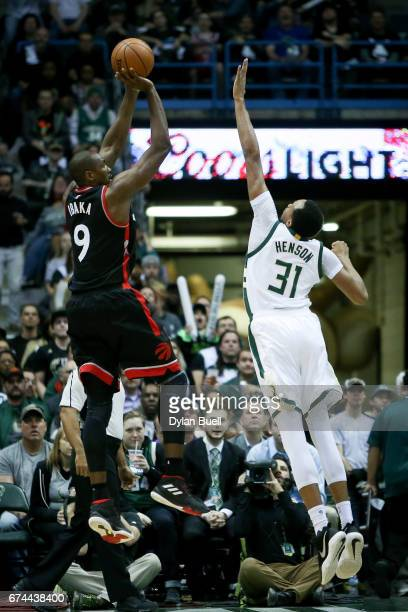 Serge Ibaka of the Toronto Raptors attempts a shot over John Henson of the Milwaukee Bucks in the second quarter in Game Six of the Eastern...