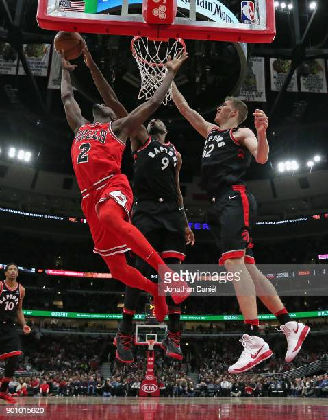 Serge Ibaka of the Toronto Raptors blocks a shot by Jerian Grant of the Chicago Bulls as Jakob Poeltl defends at the United Center on January 3 2018...