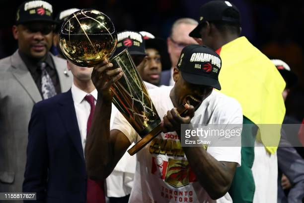 Serge Ibaka of the Toronto Raptors celebrates with the Larry O'Brien Championship Trophy after his team defeated the Golden State Warriors to win...