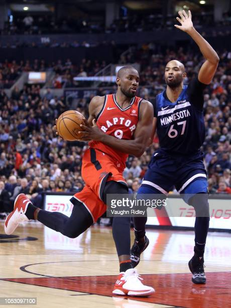 Serge Ibaka of the Toronto Raptors dribbles the ball as Taj Gibson of the Minnesota Timberwolves defends during the second half of an NBA game at...