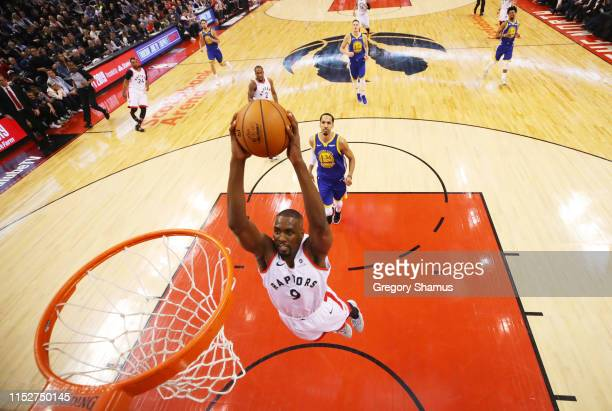 Serge Ibaka of the Toronto Raptors dunks the ball against the Golden State Warriors in the first half during Game One of the 2019 NBA Finals at...