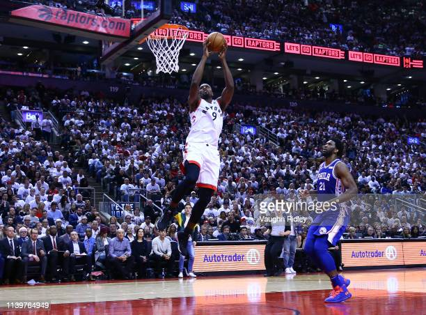 Serge Ibaka of the Toronto Raptors dunks the ball as Joel Embiid of the Philadelphia 76ers defends during Game One of the second round of the 2019...