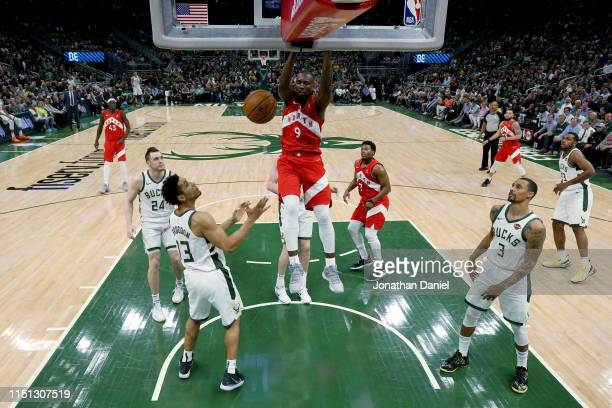 Serge Ibaka of the Toronto Raptors dunks the ball in the fourth quarter against the Milwaukee Bucks during Game Five of the Eastern Conference Finals...
