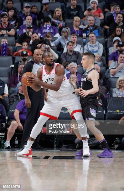 Serge Ibaka of the Toronto Raptors handles the ball against Bogdan Bogdanovic of the Sacramento Kings on December 10 2017 at Golden 1 Center in...