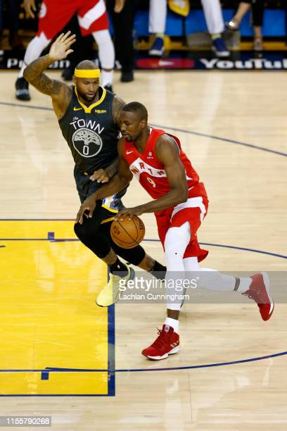 Serge Ibaka of the Toronto Raptors is defended by DeMarcus Cousins of the Golden State Warriors in the first half during Game Six of the 2019 NBA...