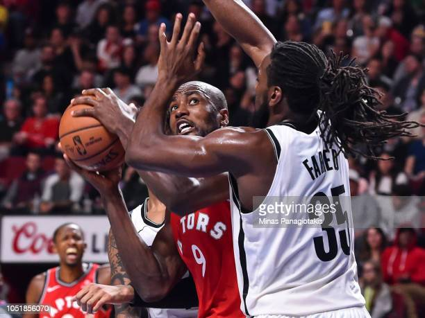 Serge Ibaka of the Toronto Raptors looks to play the ball past Kenneth Faried of the Brooklyn Nets during the preseason NBA game at the Bell Centre...