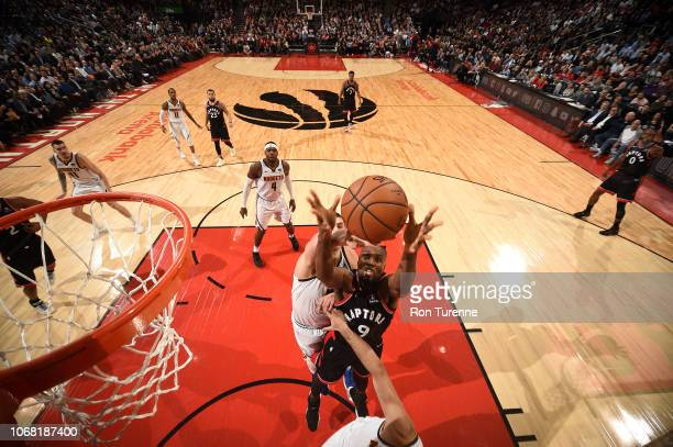 Serge Ibaka of the Toronto Raptors reaches for the rebound against the Denver Nuggets on December 3 2018 at the Scotiabank Arena in Toronto Ontario...