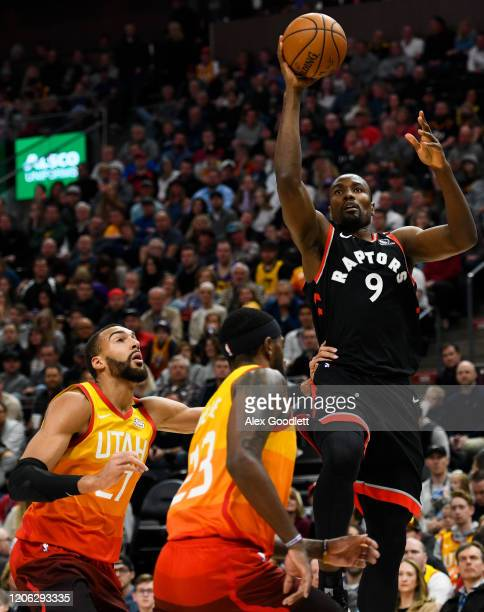 Serge Ibaka of the Toronto Raptors shoots over Rudy Gobert and Royce O'Neale of the Utah Jazz during a game at Vivint Smart Home Arena on March 9...