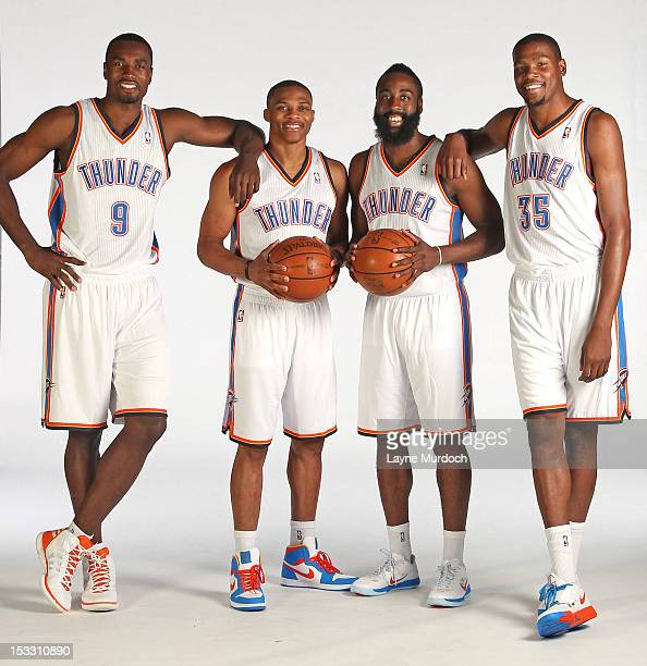 Serge Ibaka Russell Westbrook James Harden and Kevin Durant of the Oklahoma City Thunder pose for a portrait during 2012 NBA Media Day on October 1...