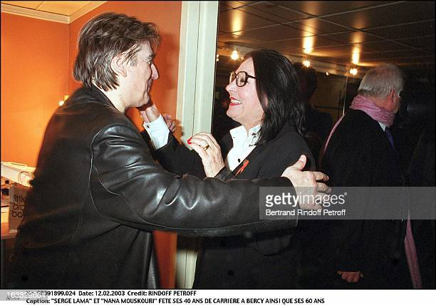 Serge Lama and Nana Mouskouri celebrate his 40 years career as well as his 60th birthday portrait glasses hugging