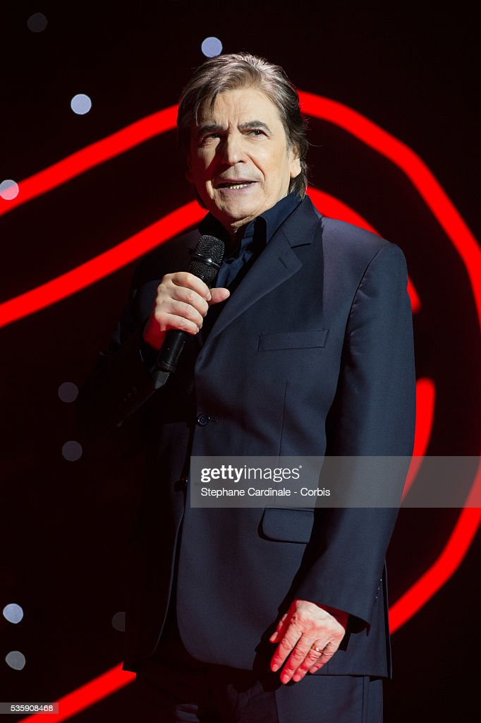 Serge Lama performs on stage after being awarded with the SACEM Special Prize during the SACEM (Societe des auteurs, compositeurs et editeurs de musique) Grand Prix awards ceremony at the Olympia, in Paris.