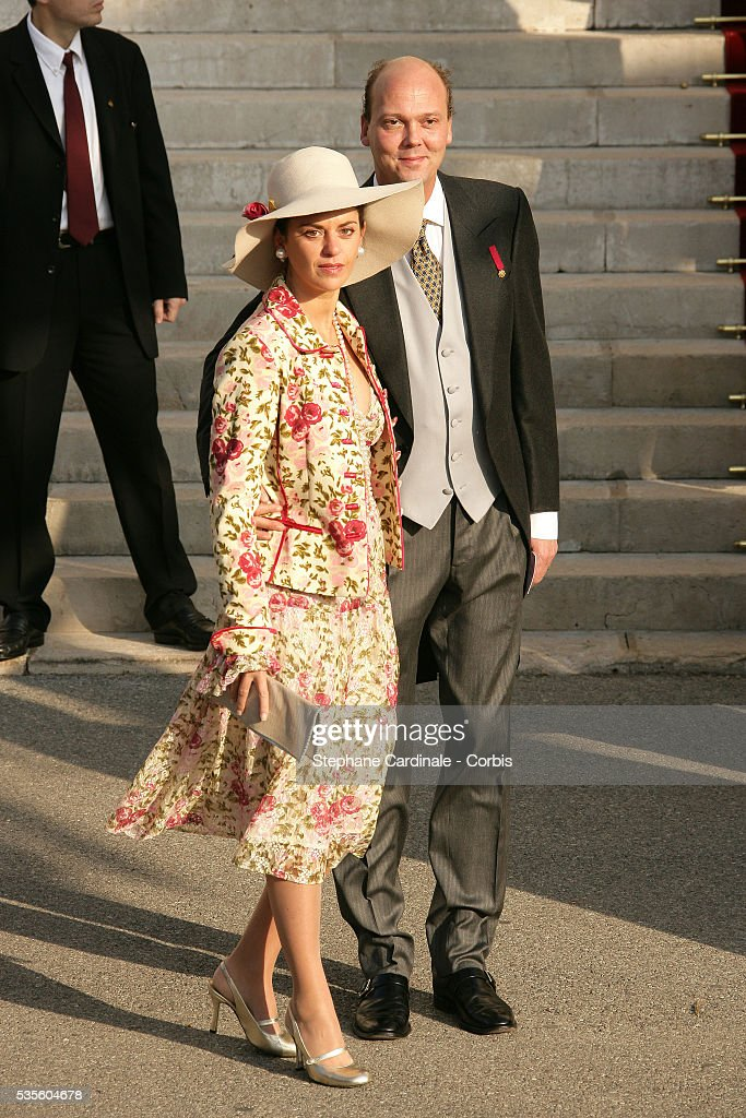 Serge of Yugoslavia and his wife attend a pontifical mass marking Prince Albert II of Monaco's formal investiture as the new ruler of Monaco at Monaco cathedral.