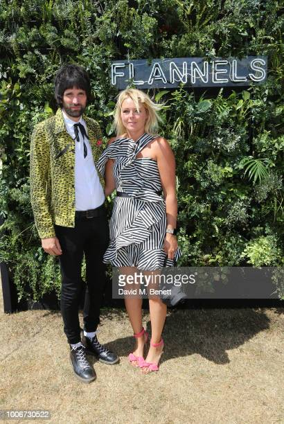 Serge Pizzorno and Amy White attend the Westchester Cup Polo at the Flannels marquee the Royal County of Berkshire Polo Club on July 28 2018 in...