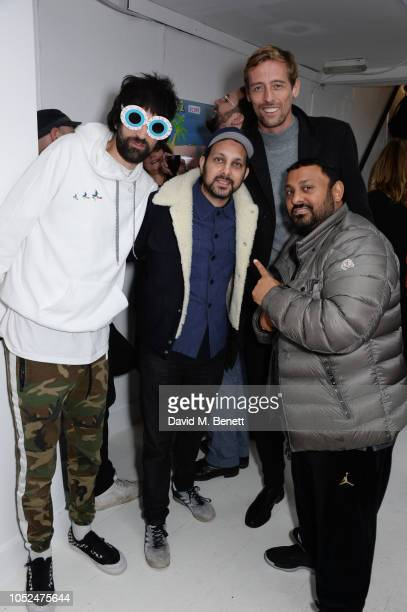 Serge Pizzorno Dynamo Peter Crouch and Prince Naseem Hamed attend a private view of Daft Apeth by Serge Pizzorno of Kasabian at No Ho Showrooms on...