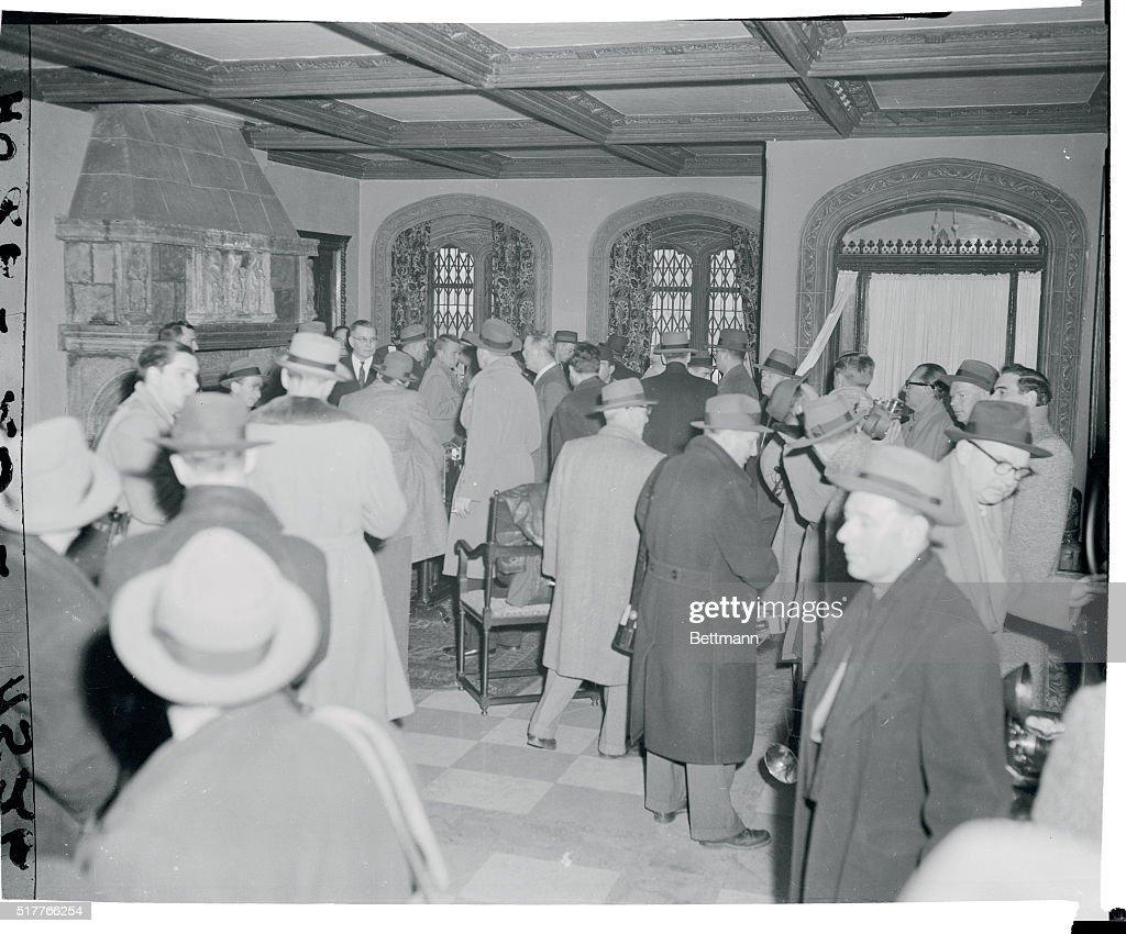 Newsmen Standing Inside Serge Rubinstein's Home : News Photo